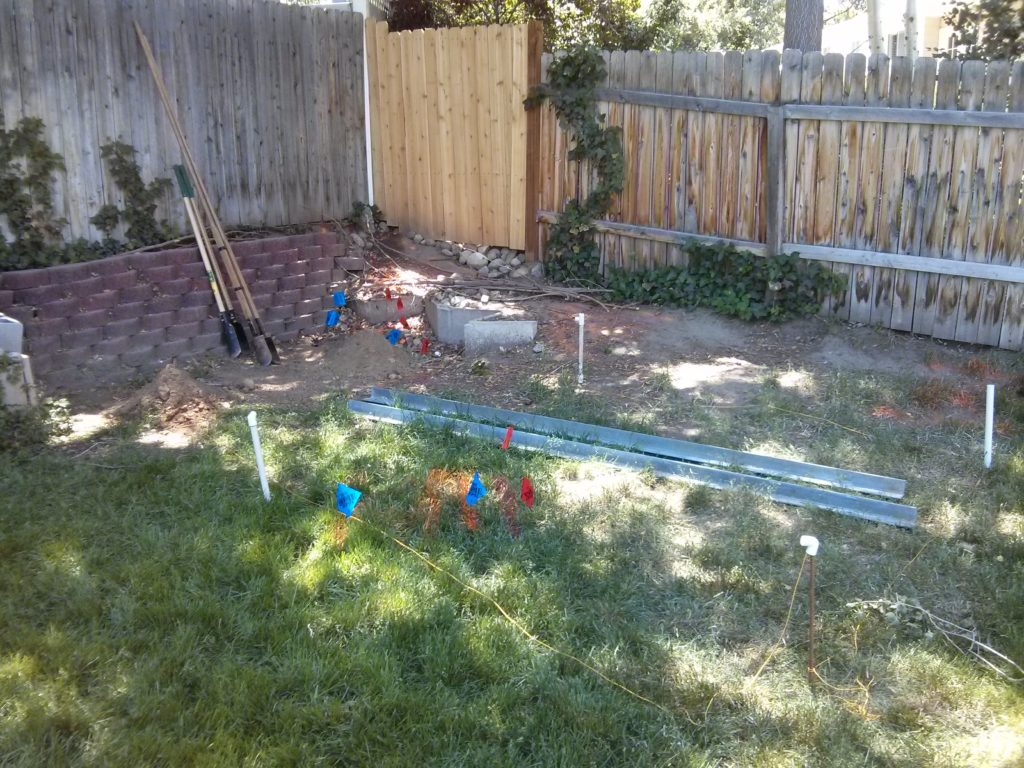 I placed rebar in the ground to measure out where I wanted my poles. PVC pipe from previous irrigation projects was used to cover the sharp tips of the rebar.