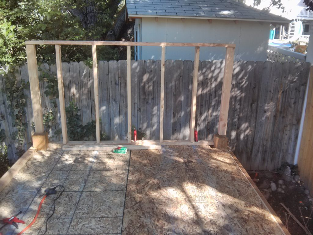 Here is the rear wall after I framed it and set it in place with clamps. Notice I forgot to cover it with the OSB.