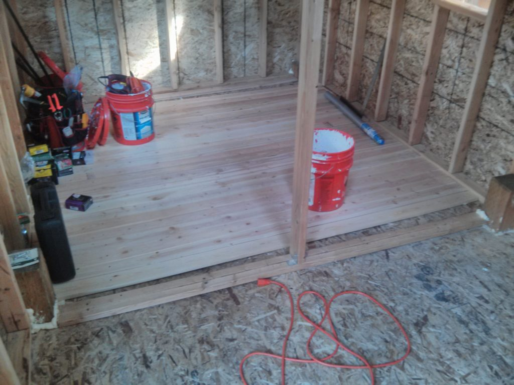 I used some 1x4's to create a new floor on top of the OSB that was already sagging.