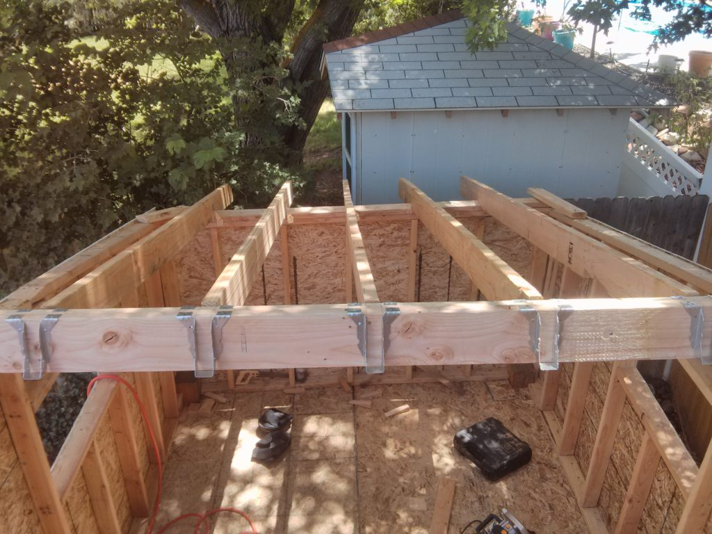 Once I figured out how to make the cuts for the ceiling joists, I got the first half of them installed.