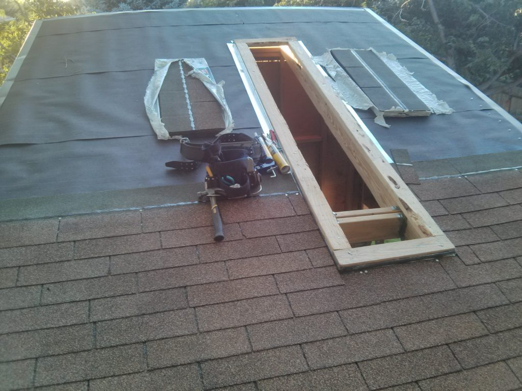 The skylight made shingling a little more challenging.