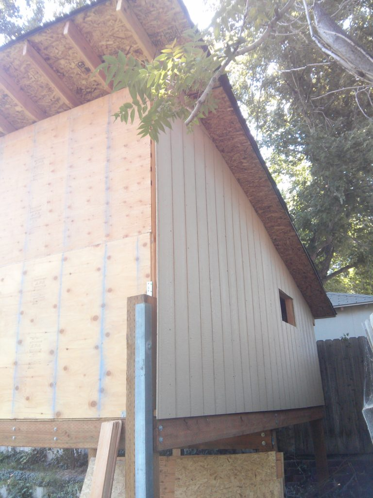 I placed Smartside panels on three of the four sides of the playhouse. I left them off the front wall as it is plywood which is more likely to hold up than the OSB on the other sides.